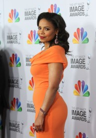 Sanaa Lathan -orange dress